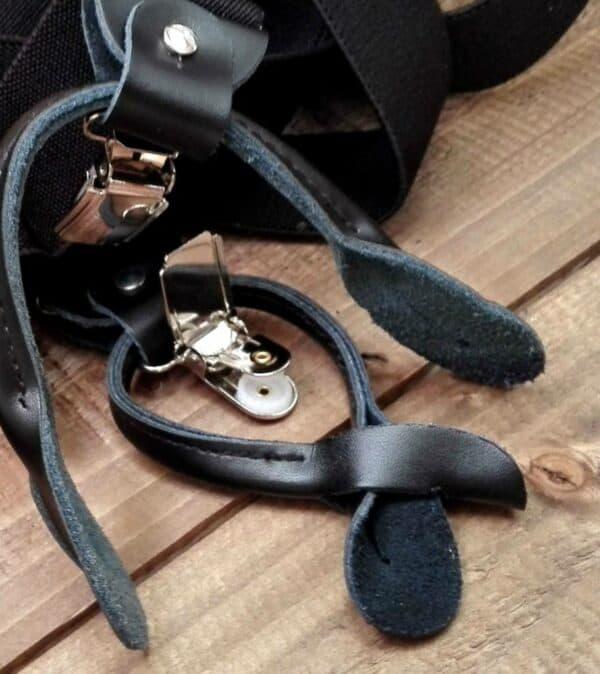 zwarte bretels met knoop